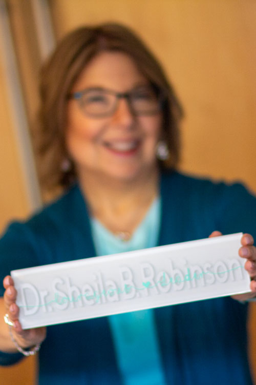 Sheila with official Dr. Nameplate