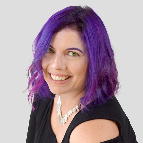 Stephy Hogan with her purple hair, smiling